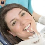 Deciding on a Dental Implant, Bridge, or Denture in Richmond